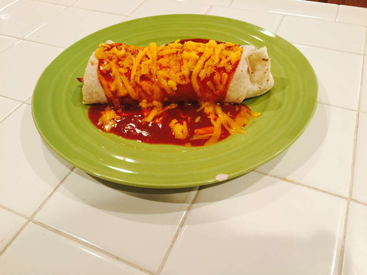 fresh carne burrito covered in cheddar cheese and enchilada sauce