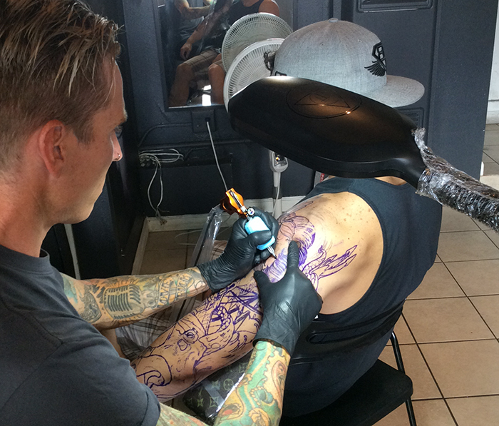 Here is a picture of Matt Tischler in San Clemente tattooing at the local Wild at Heart tattoo parlor.