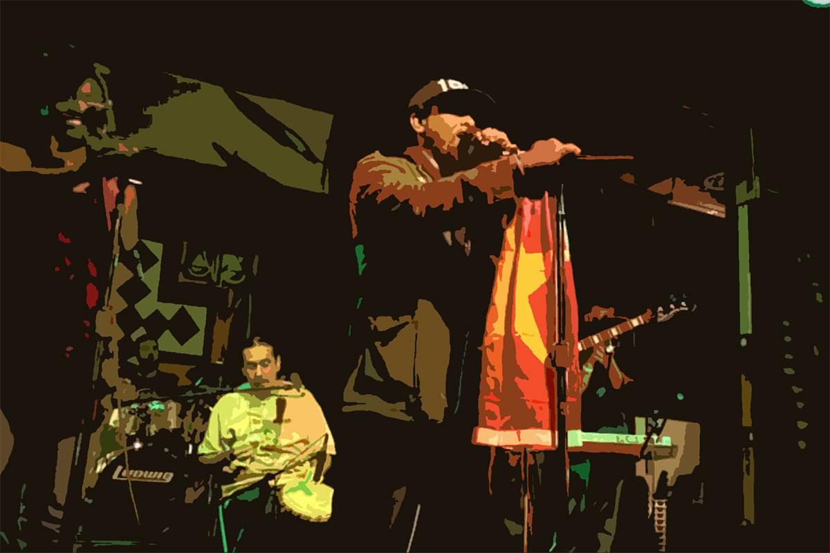 Here is an image taken of Tadasse at The World Beat Center in San Diego. He is up on stage
