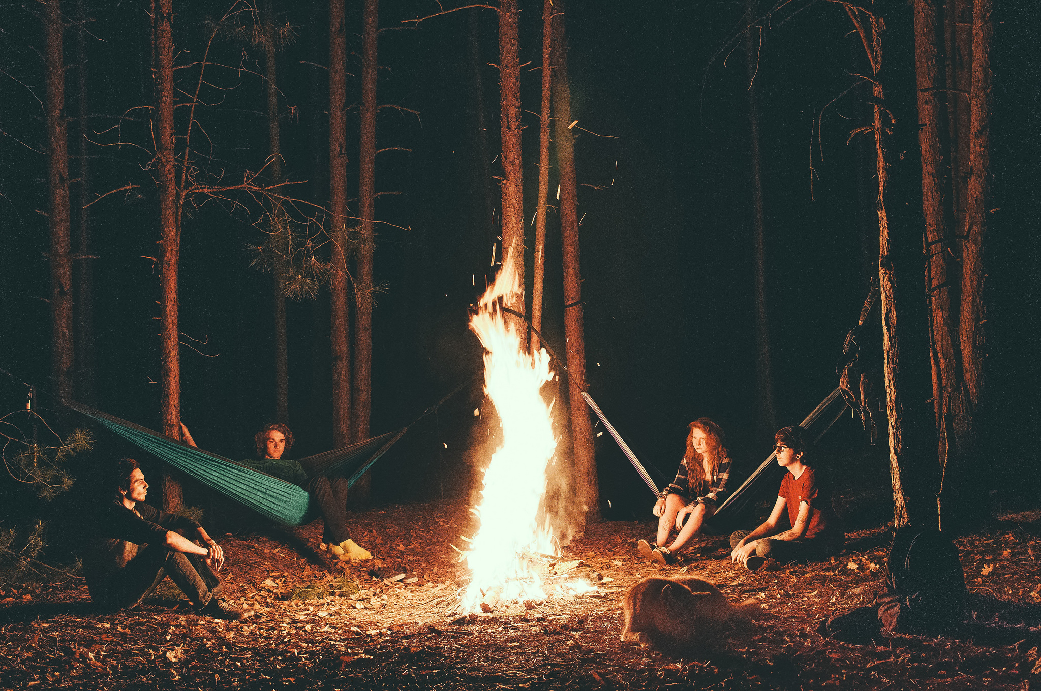 Campers sit around the fire enjoying the hammocks they decided to bring. ( Casey Garner/ Creative Commons)