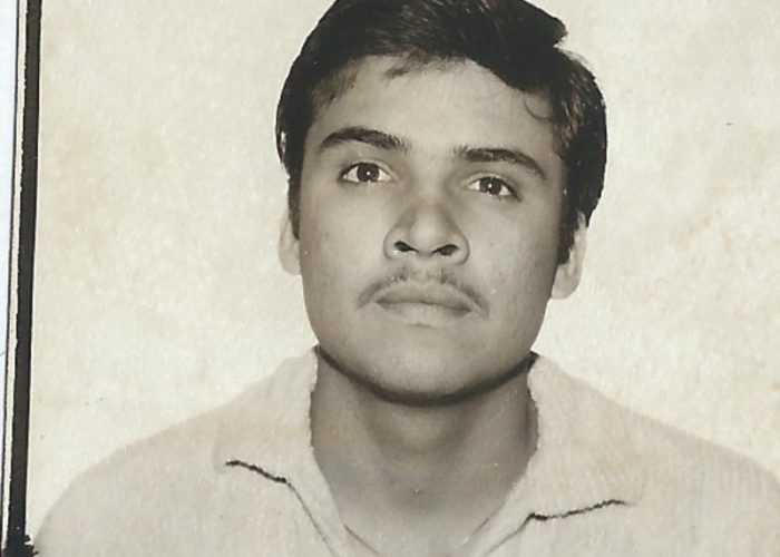 My father's picture taken for his green card taken in 1985