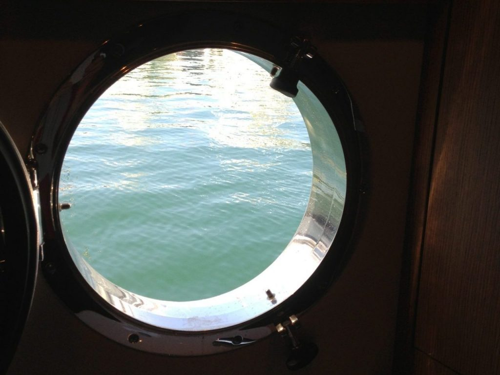 Porthole on Ferry Crossing Messina Strait, Italy (Birute Ranes)