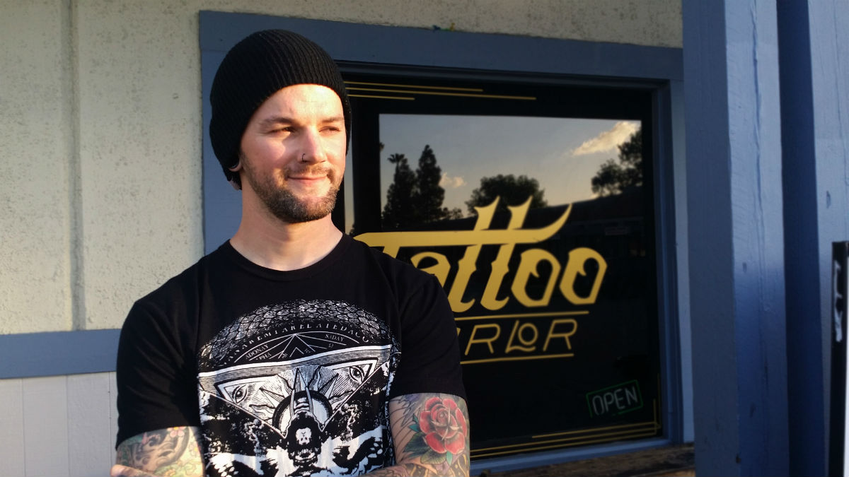 """Without my heart taking a crap on me, I wouldn't be where I am today,"" says Kyle Blackburn, head piercer and tattoo apprentice at True at Heart Tattoo Shop. (Photo by: Jenna Sergeant)"