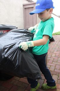 Ryan Hickman, 7, hard at work collecting recyclables for his business. ( Taya Buehler-Reagan)