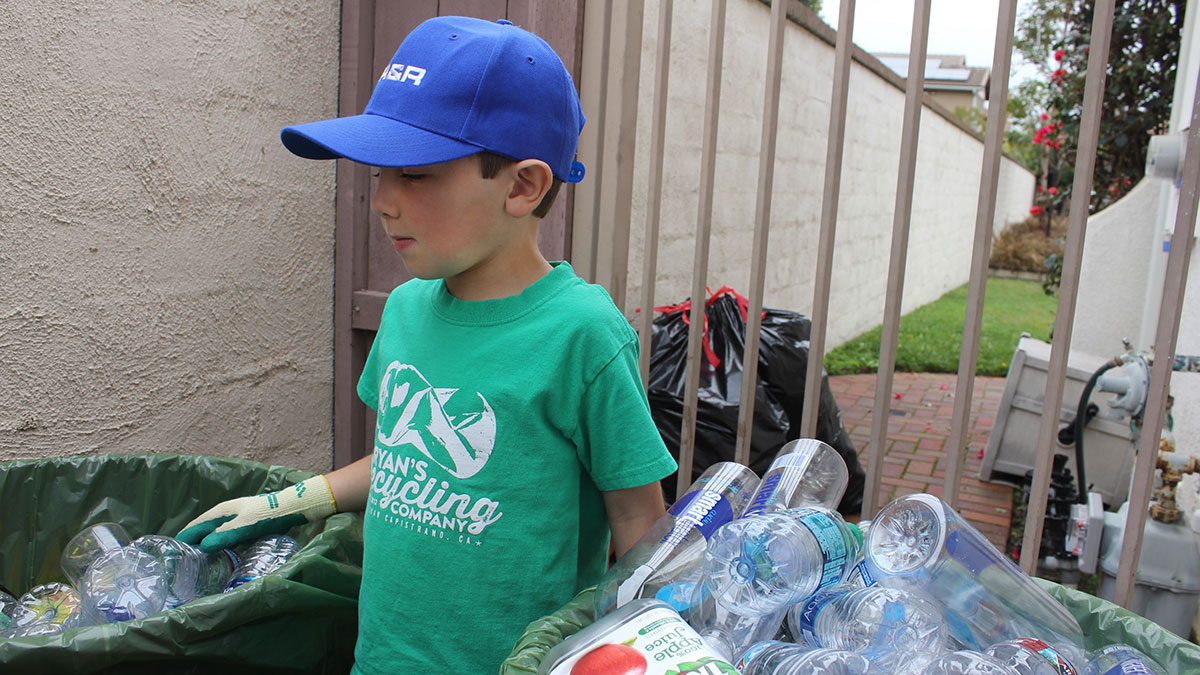 """I like to recycle because then bottles and cans won't go into the ocean, and then animals won't get sick and they won't die,"" Hickman says. (Taya Buehler-Reagan)"