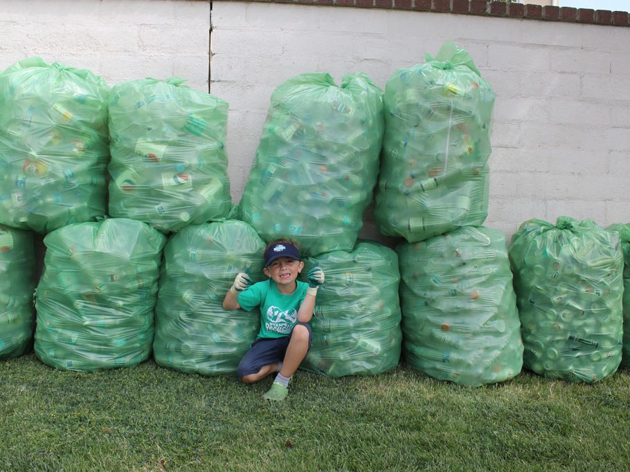 Ryan poses in front of his 20+ bags on recycling (Taya Buehler-Reagan)
