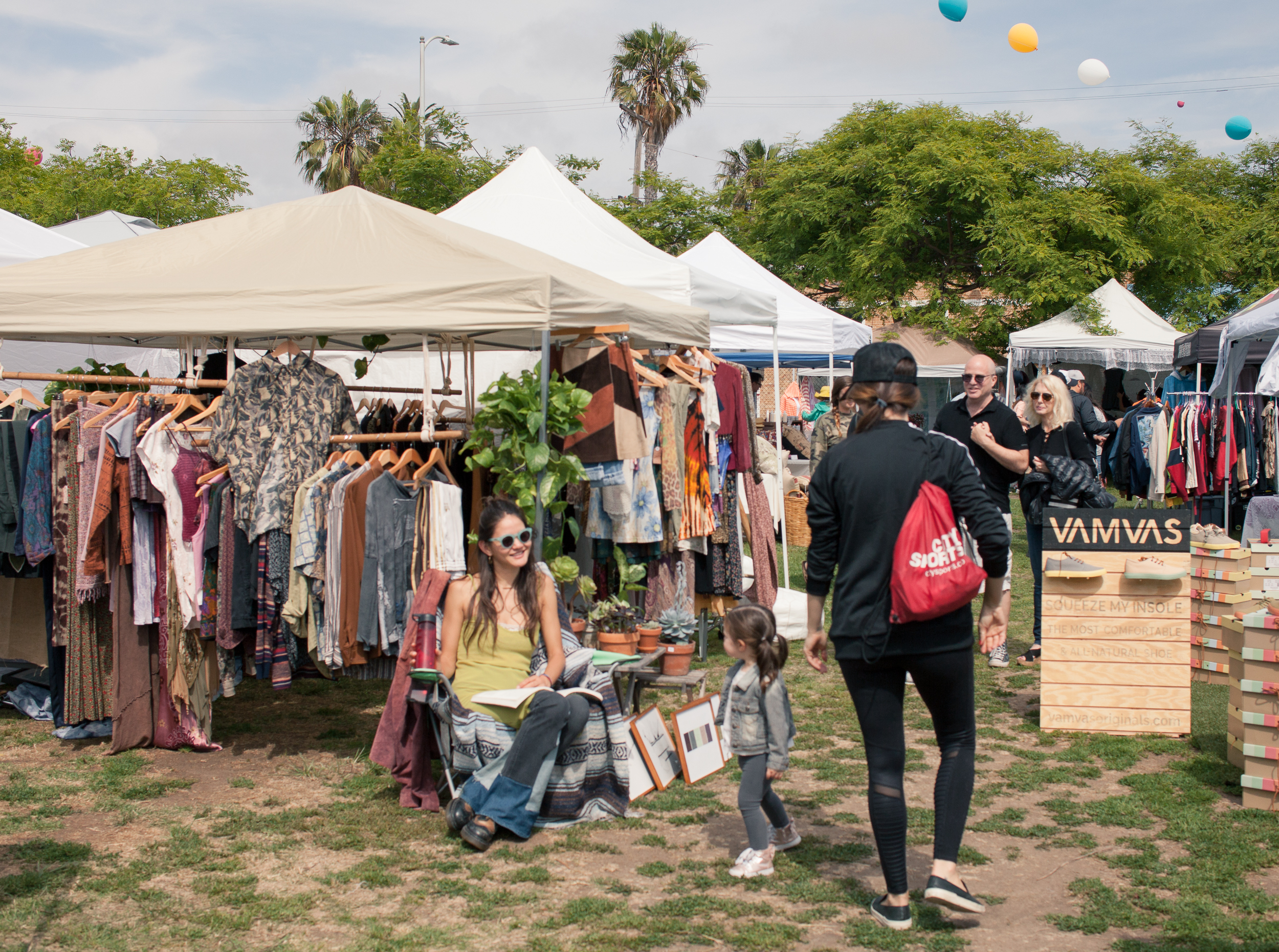 Shoppers checking out one of the many vibrant vendors (Photo provided by Artists and Fleas)
