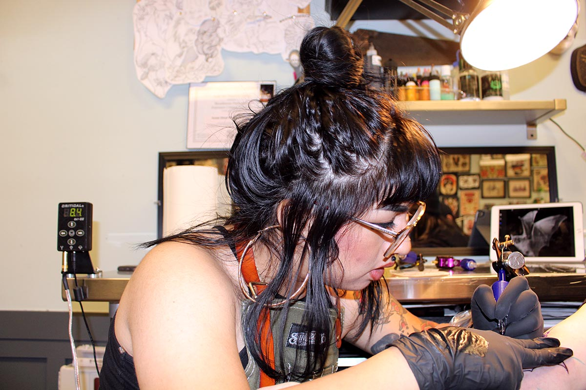 Sanchez tattooing a client at Black Palm Tattoo. (Ashley Hern)
